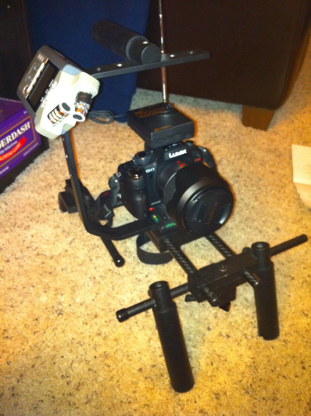 Nick found this photo from 2010, when he and I shared a Panasonic GH1 camera, 14-140mm lens, Zoom H4n audio recorder, ULTRAcompact shoulder rig, and Azden wireless mic system.
