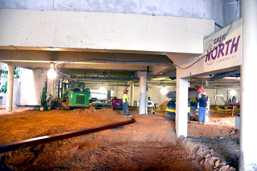 What was formerly the lower parking deck beneath the Peachtree Landing and entrance into Great North (elementary) is being demoed to make room for the new children's space. This will become the children's common area.