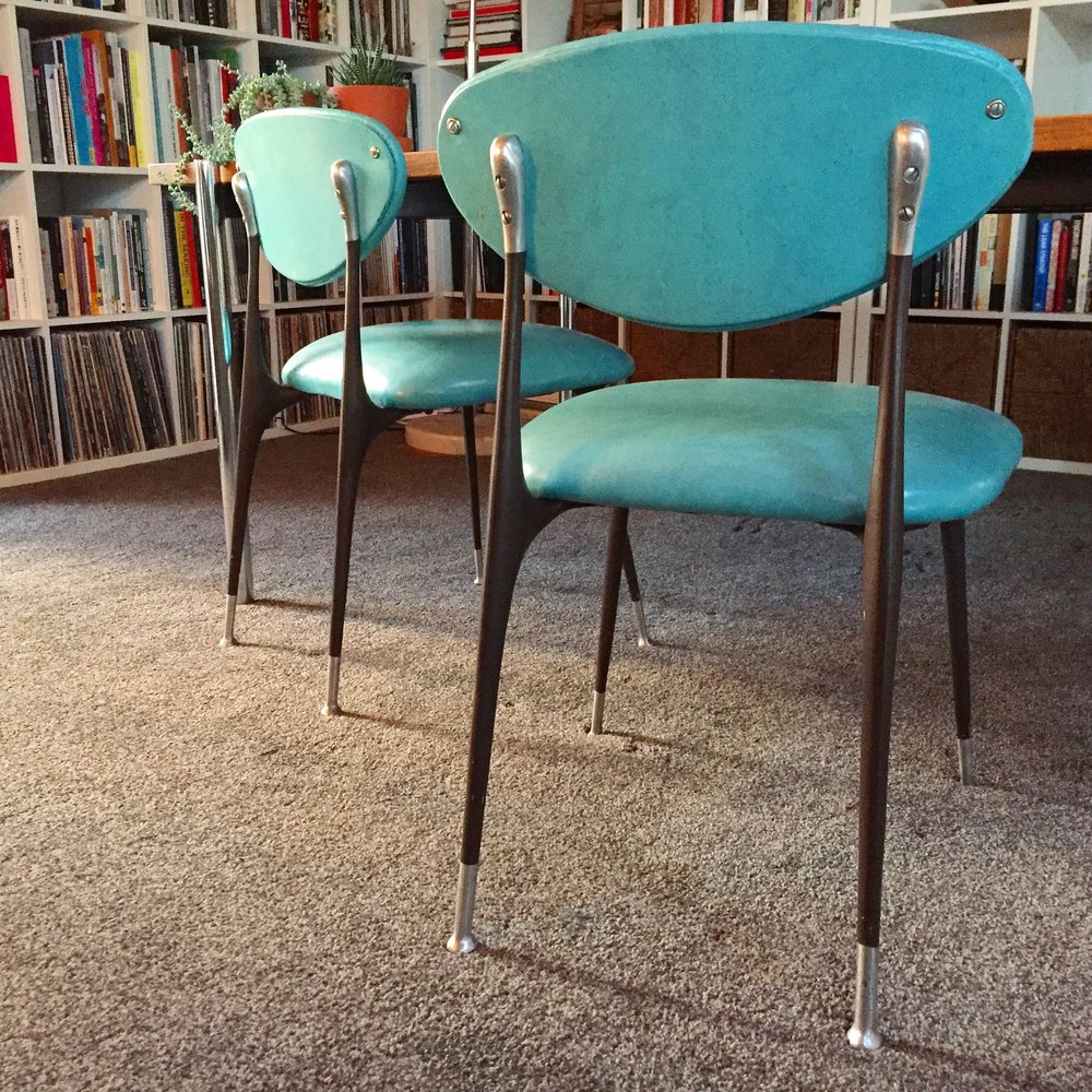 Den with teal chairs.jpg