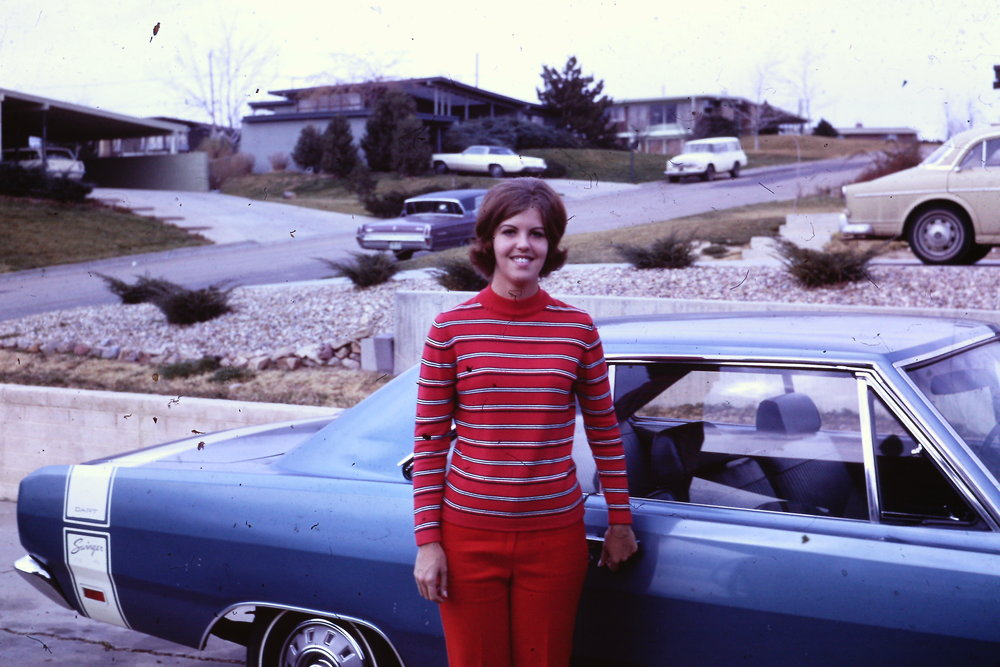 Stylish Tricia Gravenstein, a Northglenn resident, stands in front of her classic blue Dodge Dart Swinger. Talk about midcentury flair.