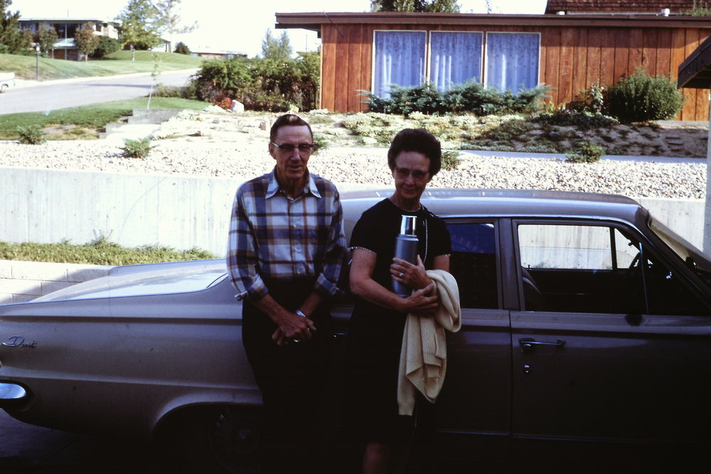 These adorable grandparents pose in front of the Wodd house in the Deza Estates neighborhood on a sunny Colorado day.