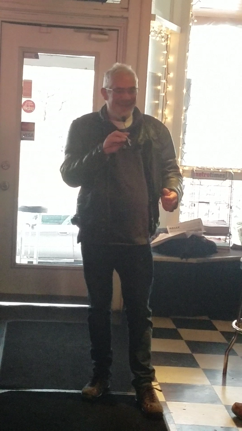 Roy speaking at a local welfare event