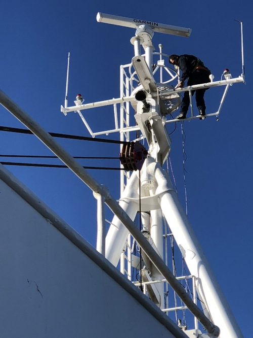 Joe running final wire connections to various equipment on the A Frame (front mast).