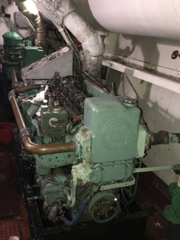 The two Detroit Diesel generators on the port side of the lower level of the engine room. Generator #1 is in the foreground.