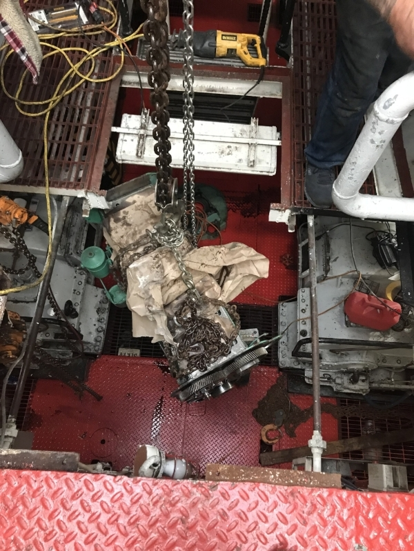 The engine block for generator #2 has been moved to the center of the engine room. The catwalk has been cut out and we are moving it up to deck #2. The block probably weighs 1,000 lbs