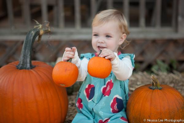 Seven Pumpkin Patch Photo Tips, Toddler girl with pumpkin