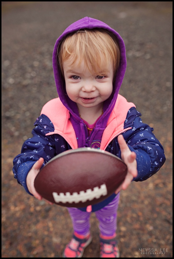 Toddler girl with football