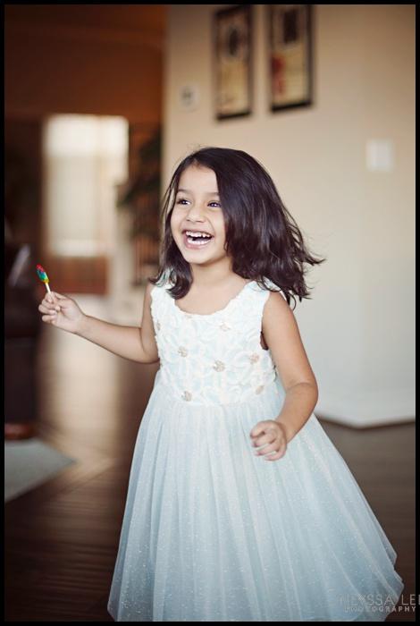 Preschool Girl spinning in pretty dress
