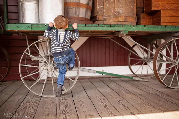 Photos of Brotherly Love, Preschool boy climbing, wagon used in photo
