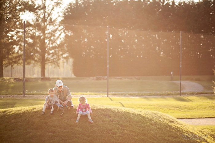 Backlit image, kids with grandpa, Golf course