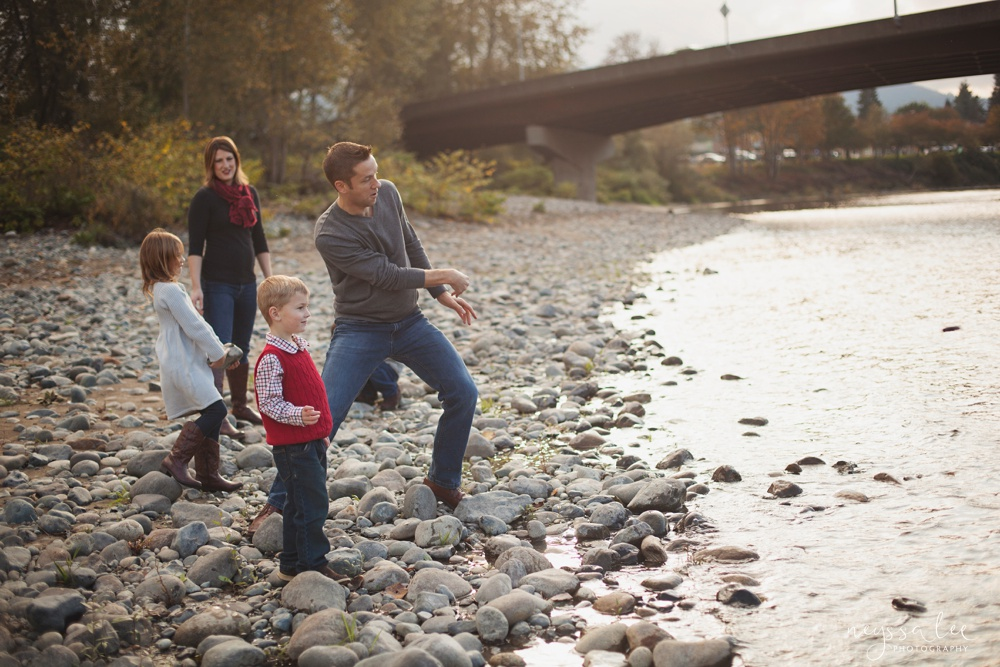 dancing in the sunshine, family photography, family photo by the river, skipping rocks