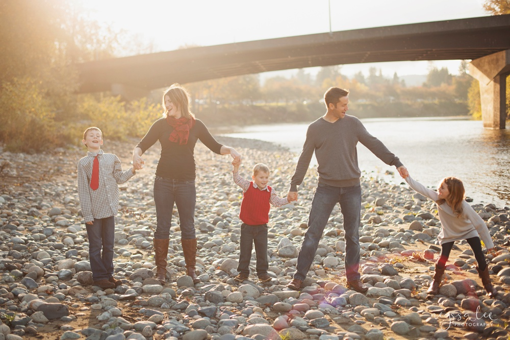 dancing in the sunshine, family photography, family photo by the river