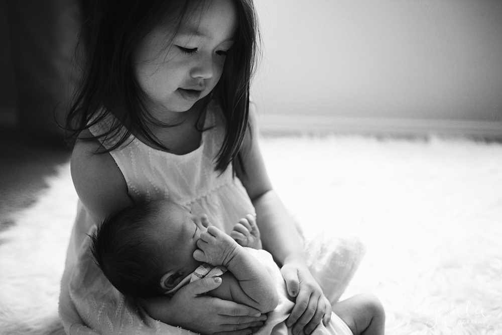 sisters, newborn baby, family photography, toddler girl with baby sister
