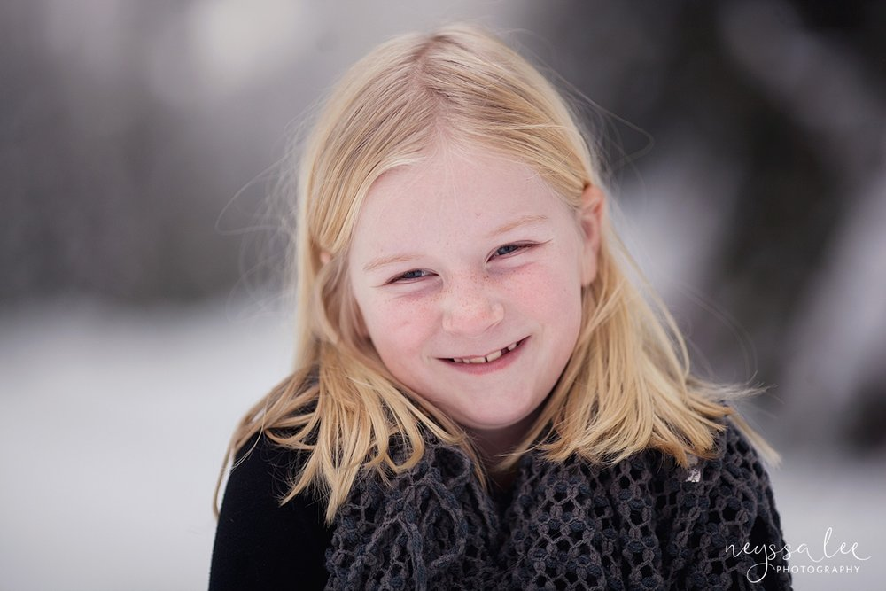 Neyssa Lee Photography, Snoqualmie Family Photographer, Family photos in the snow, Girl smiling in the snow