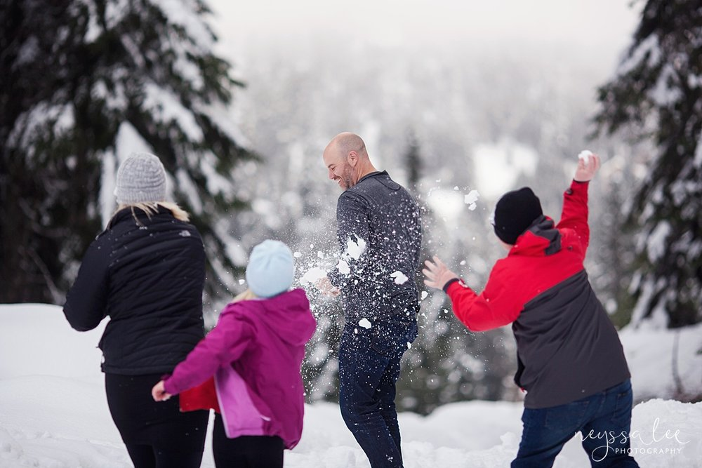 Neyssa Lee Photography, Snoqualmie Family Photographer, Family photos in the snow, throwing snow at dad, Snoqualmie Pass