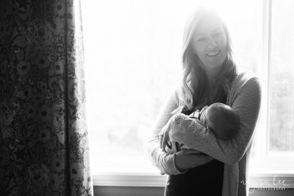 Snoqualmie Newborn Photographer, Neyssa Lee Photography, Newborn boy in mom's arms, black and white lifestyle newborn photo