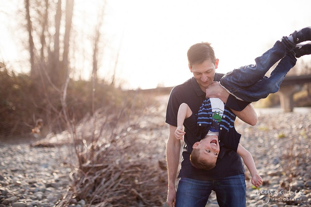 Family Photos by the River at Sunset, Neyssa Lee Photography, Snoqualmie Family Photography, Dad hangs son upside down