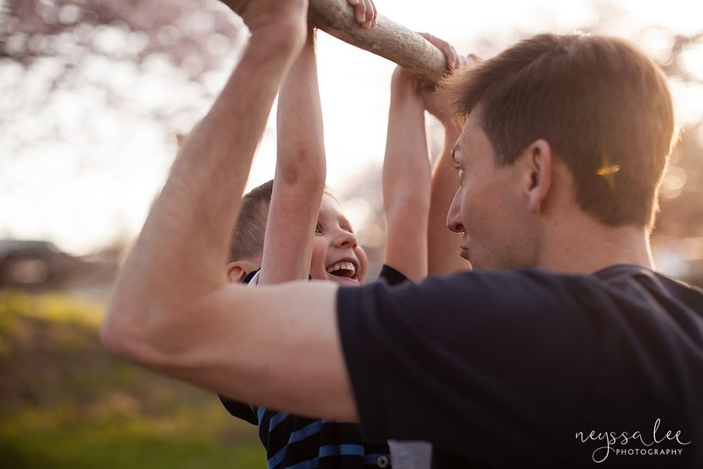Family Photos by the River at Sunset, Neyssa Lee Photography, Snoqualmie Family Photography, Family of Four, Dad lifts son with branch