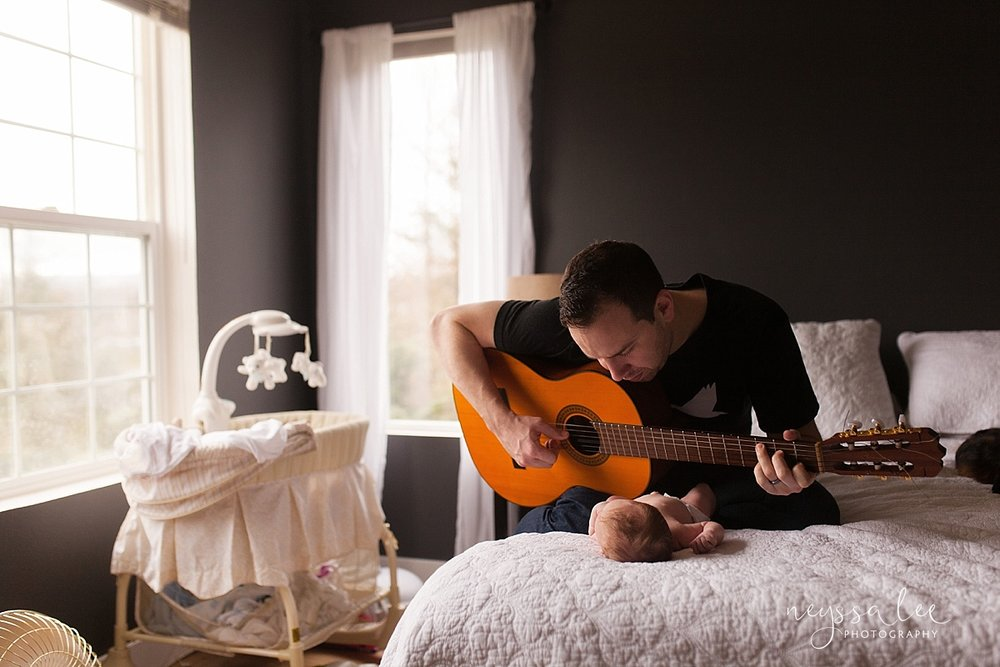 Seattle Newborn Photographer, Father playing guitar for newborn baby