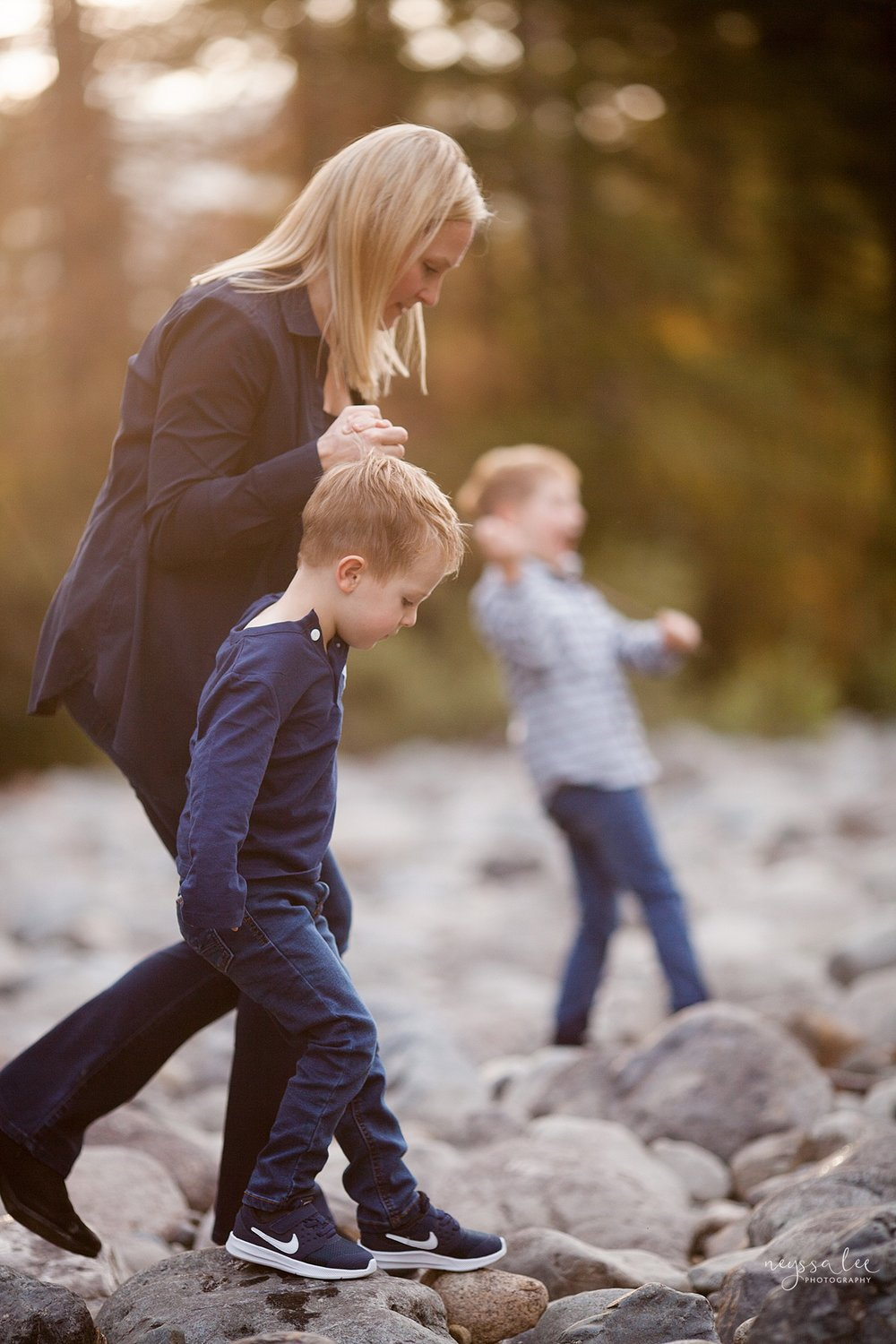 Snoqualmie Family Photographer, Neyssa Lee Photography, Fall Family Photos, Change of perspective on family photos, Mother and son walking on river rocks