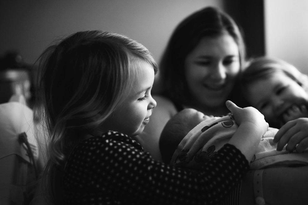 Photo by Megann Robinson - My girls meeting their baby brother for the first time.