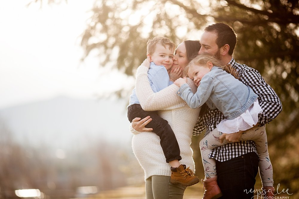Neyssa Lee Photography, Seattle Maternity Photographer, Family Snuggled together with beautiful light