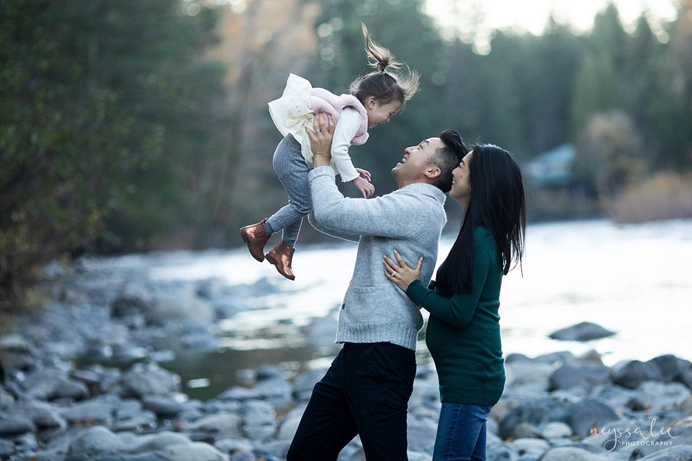 Neyssa Lee Photography, Seattle Lifestyle Family Photographer,  Photo of dad tossing daughter into the air with mom smiling nearby