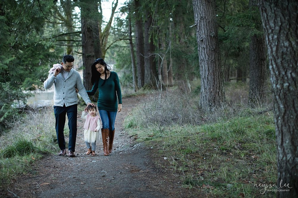 Neyssa Lee Photography, Seattle Lifestyle Family Photographer,  Photo of Mom and dad walking along a wooded trail with daughter