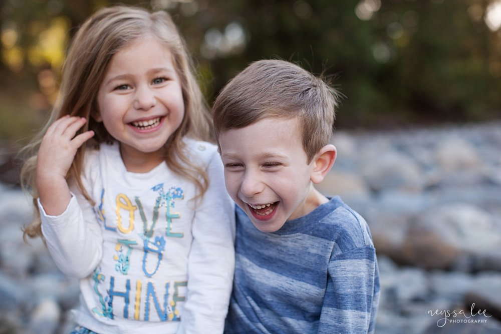 Neyssa Lee Photography, lifestyle family photography, Seattle Family Photographer, Photo of brother and sister laughing together, relaxed sibling photo