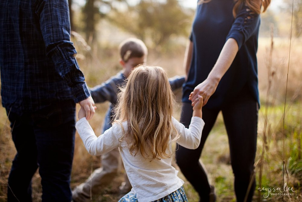 Neyssa Lee Photography, lifestyle family photography, Seattle Family Photographer, Artistic photo of family holding hands playing together