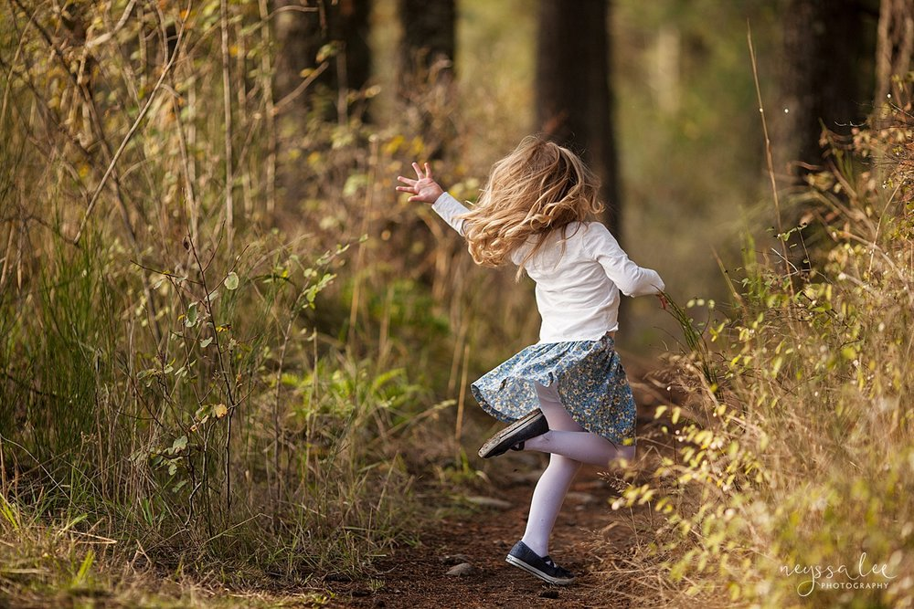 Neyssa Lee Photography, lifestyle family photography, Seattle Family Photographer, Photo of girl twirling in field