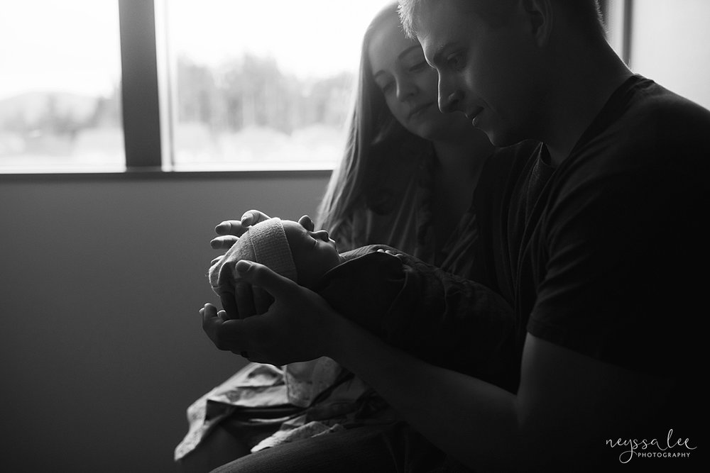 Neyssa Lee Photography, Issaquah Fresh 48 Photographer, Hospital Photos, What to wear for Fresh 48, pack hospital bag, black and white photo of mom and dad admiring newborn baby in hospital