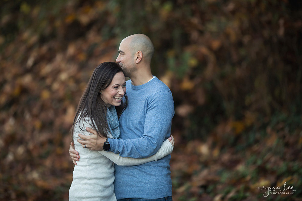 Neyssa Lee Photography, Snoqualmie Family Photographer, Large family photo, Lifestyle photo of mom and dad laughing together