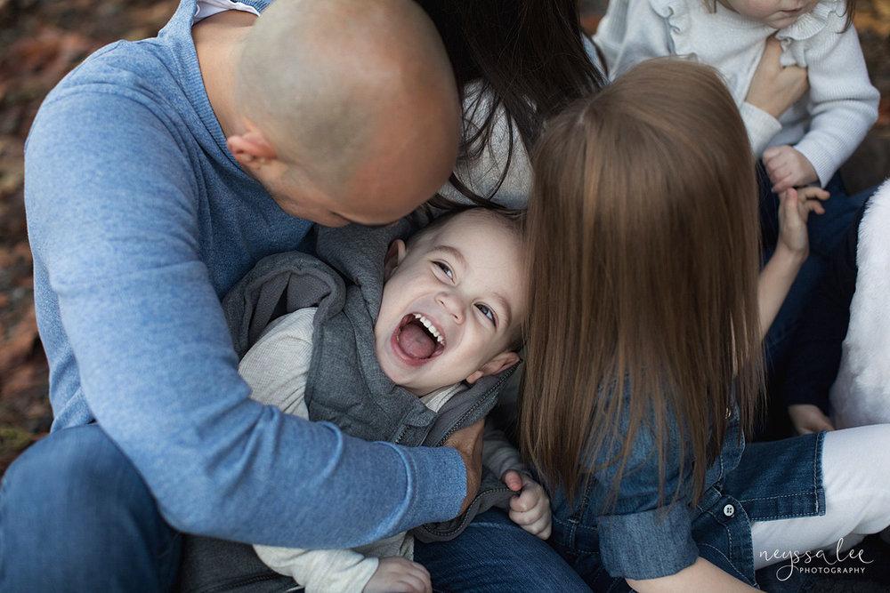 Neyssa Lee Photography, Snoqualmie Family Photographer, Large family photo, Lifestyle photo of father tickling son
