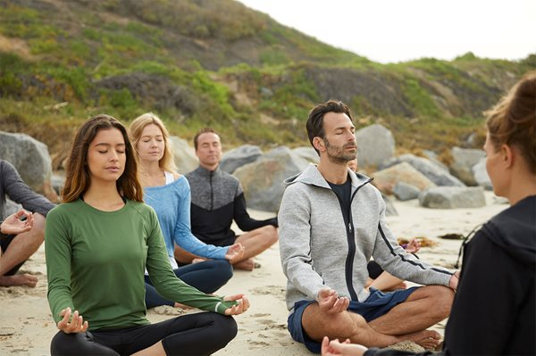 membership-hero-banner-group-beach-meditation-classes-spa-resort.jpg