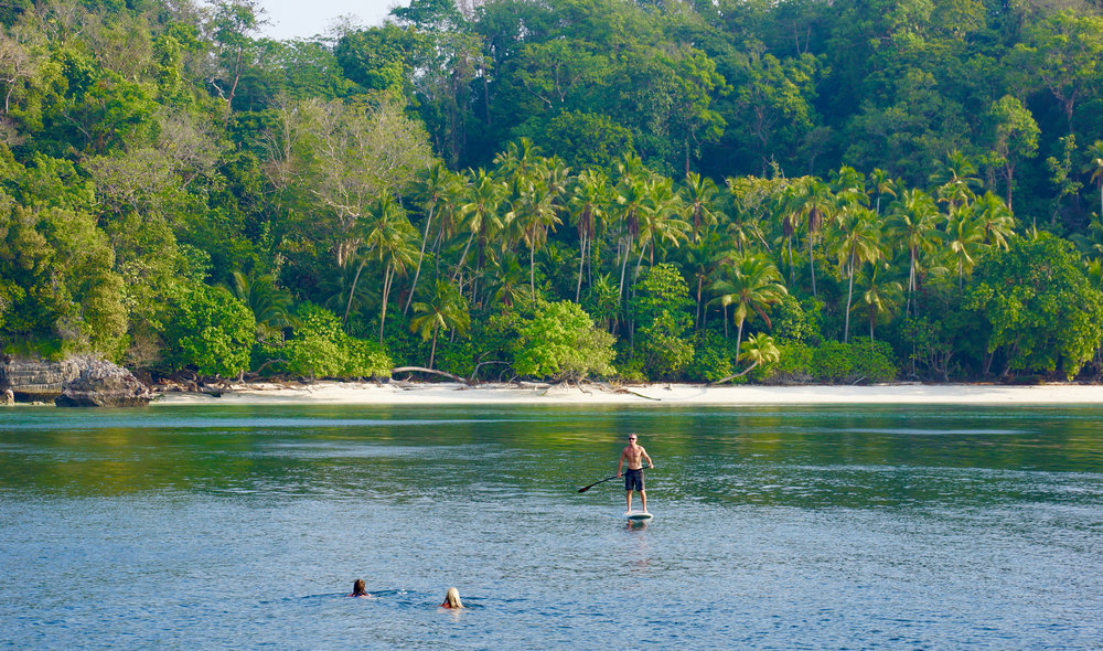 Paddlebaording and swimming to an island where not many have set foot.  Somewhere in Indonesia.