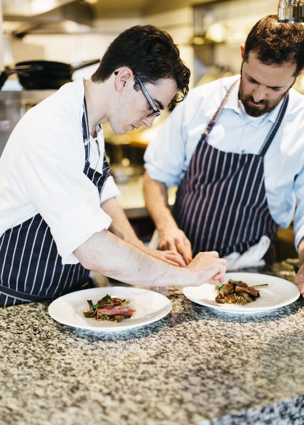 Michael Piazza Photography Chefs Chris McMullan, left, and Tony Maws plate a meal at Craigie on Main.