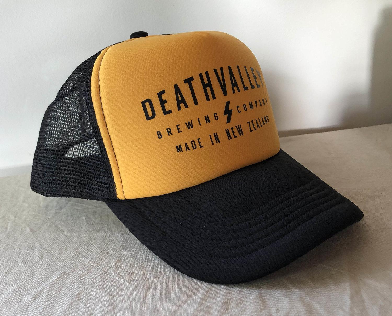 d8183f823ca Death Valley Trucker Cap  Black + Yellow  — Death Valley Brewing Co