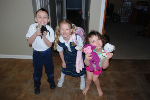 Mason, Kaitlyn, and Julie, showing off their favorite toys.