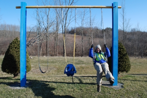 Tara wants to stop and swing every time she sees a swing set. Today, she couldn't resist the urge.