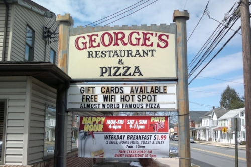 "We didn't eat here, but we are hoping to make George's ""Almost World Famous Pizza"" entirely world famous. Maybe our ten readers will push him over that edge!"