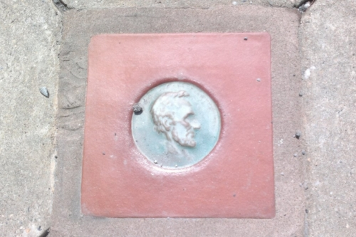 These are embedded in the sidewalk along the Lincoln Highway in Columbia, PA.