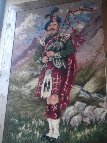 The bagpiper is hanging in a Greek restaurant. I think I must have missed a day of history class.