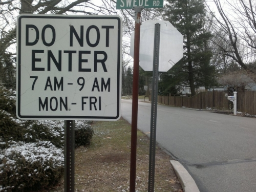 This sign is posted on both entrances to a neighborhood. What happens if you want to go home during those hours?