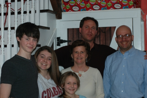 From left to right: Charlie, Evie, Lauren, Mary Beth, Paul, William. Not pictured is Cody, their ferocious watch dog.