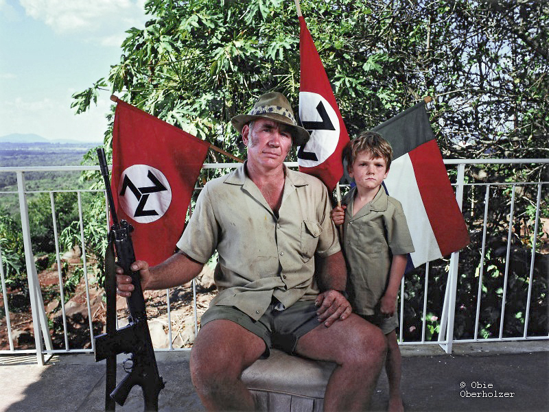 A father and son, members of the Neo-Nazi AWB movement, pose for the camera near Tzaneen in the Limpopo Province. © Obie Oberholzer