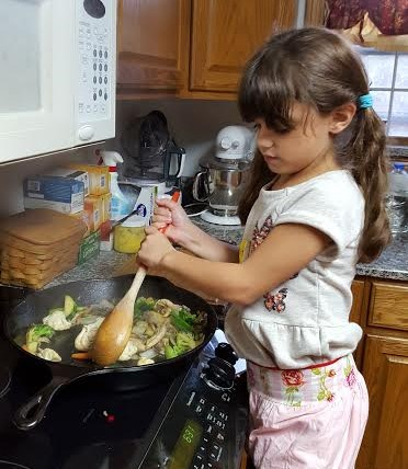 My daughter loves helping in the kitchen.