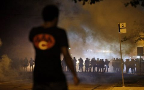 Police clashing with protesters in Ferguson, Missouri Jeff Roberson/AP