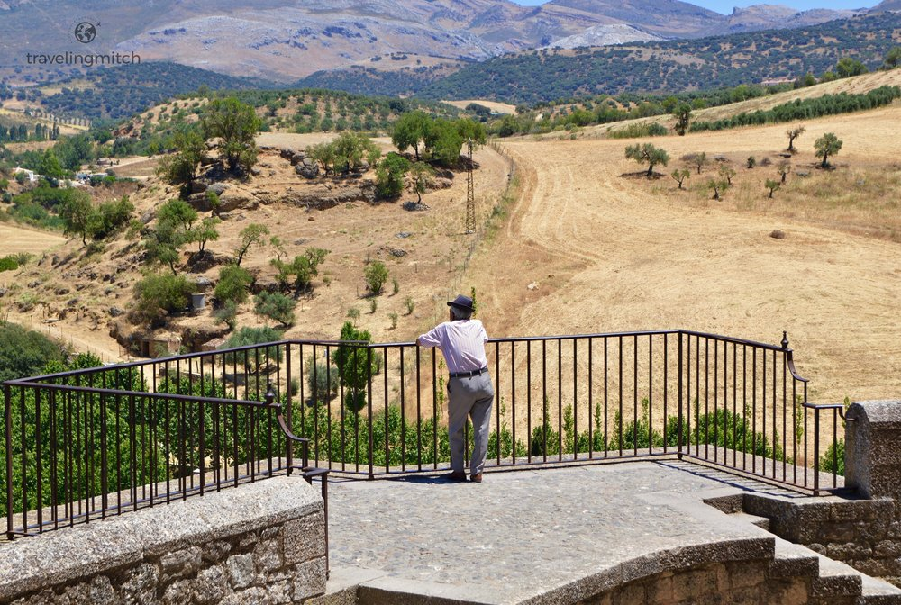 A man stares of into the distance in Ronda, Andalusia, Spain