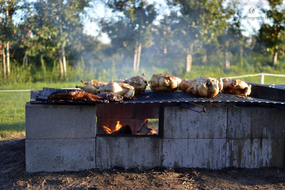 Meat cooks over the fire at Hayfield Farms near Orono, Ontario